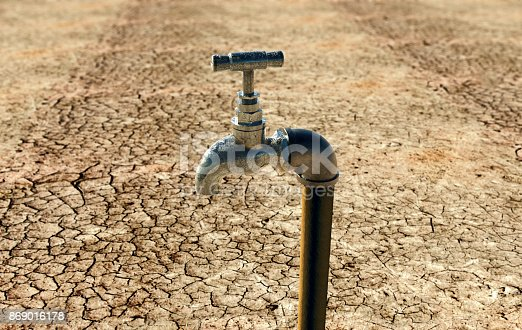 istock old metal water tap in dry surrounding 869016178