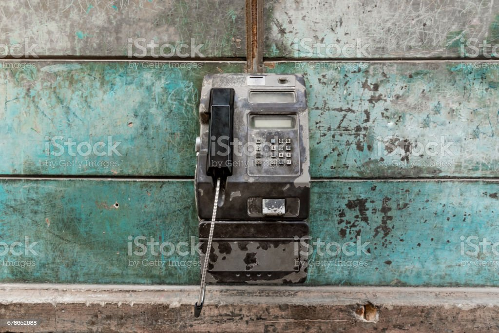 old metall public pay phone on vitage wall in Havanna