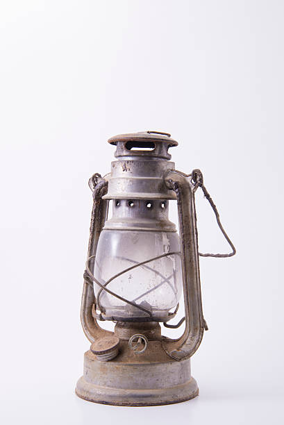 Old metallic dirty and rusty kerosene lamp stock photo