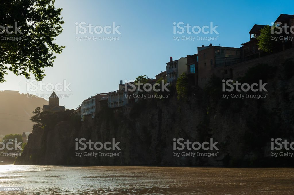 Old Metekhi district, in the rock above the river Kura on the sunset stock photo