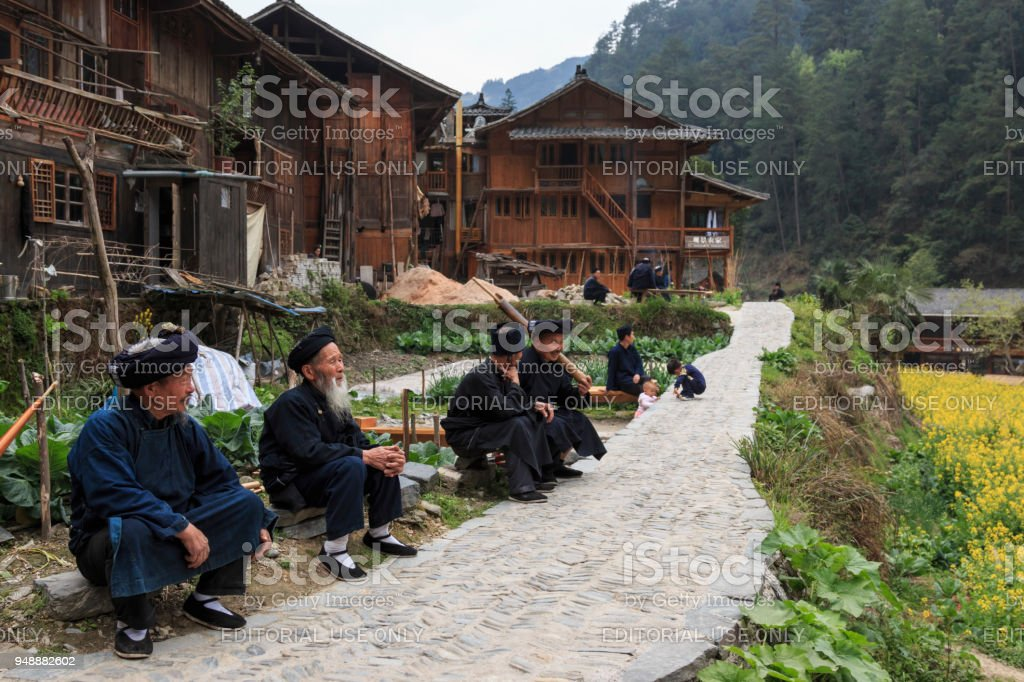 Old Miao men chatting in Langde Miao village, Guizhou province, China stock photo