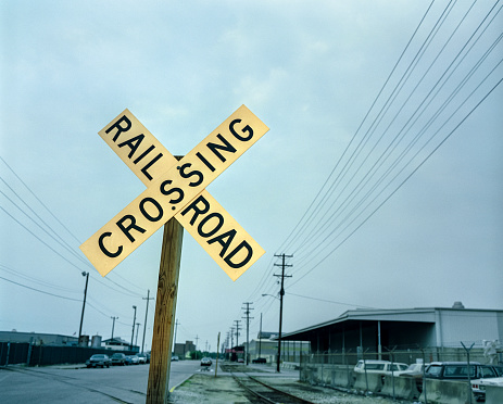 Old Midwest railroad  warning crossing sign at dawn
