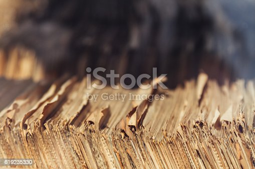 istock Old migrations paper records stacked in wooden box 619235330