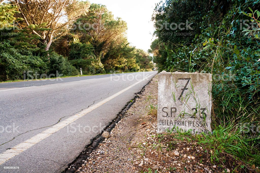 Old mileston along a provincial road in Tuscany stock photo