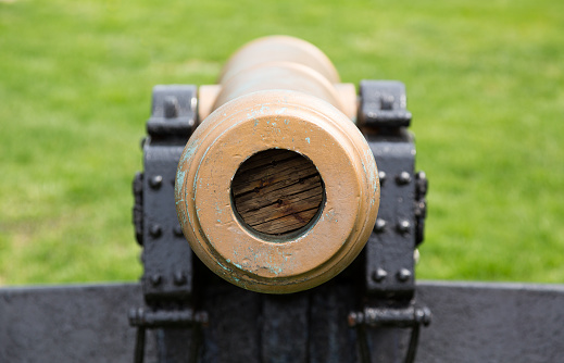 Old military cannon pointing straight at viewer