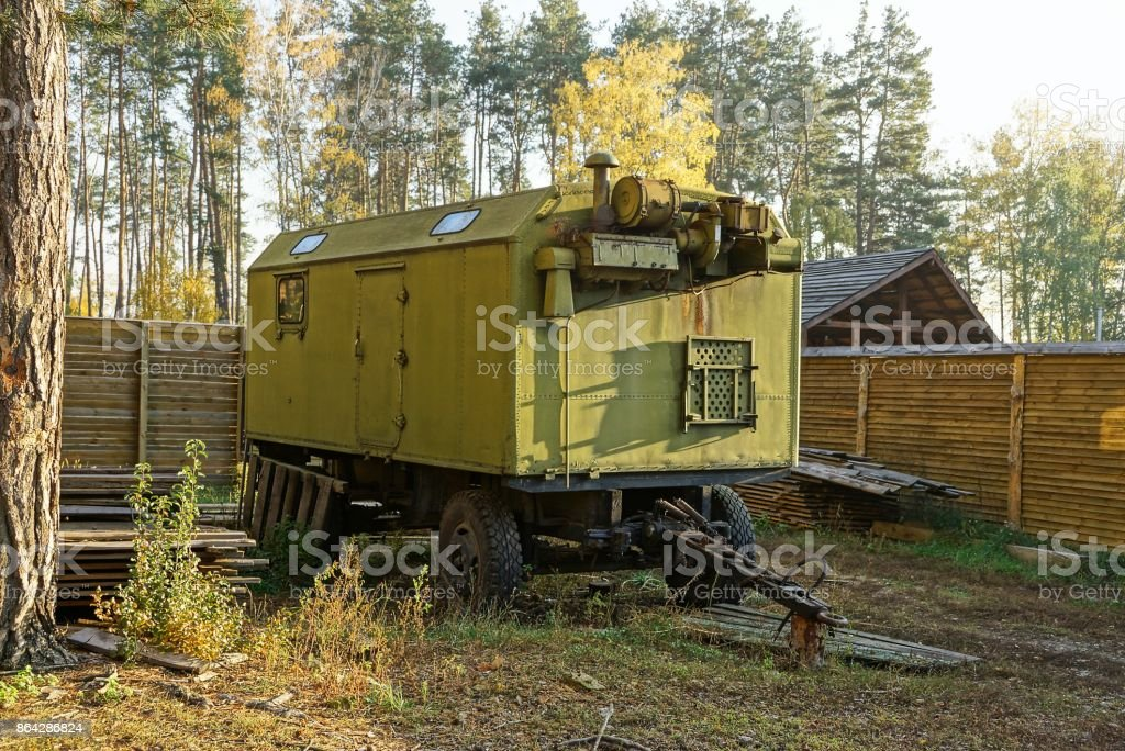 old military trailer with a courtyard in the yard royalty-free stock photo
