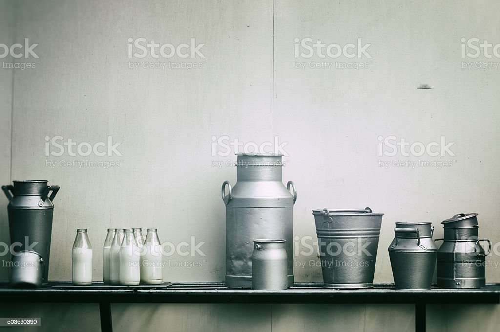 Old milk jugs, cans and bottles stock photo