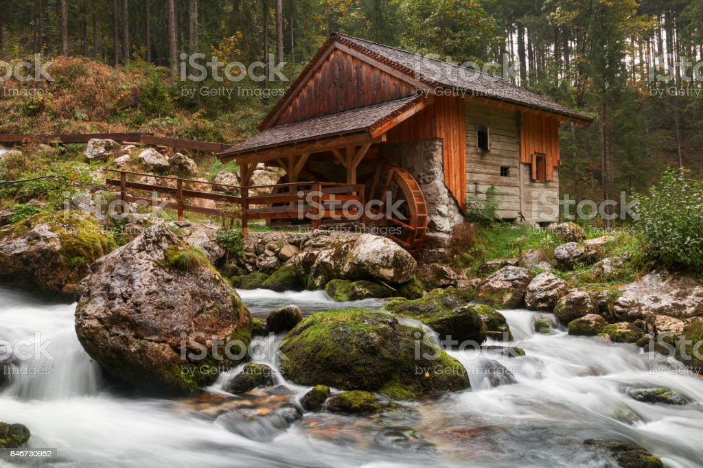 Old mill and beautiful Golling waterfall and near Golling and Salzach medieval town at autumn stock photo