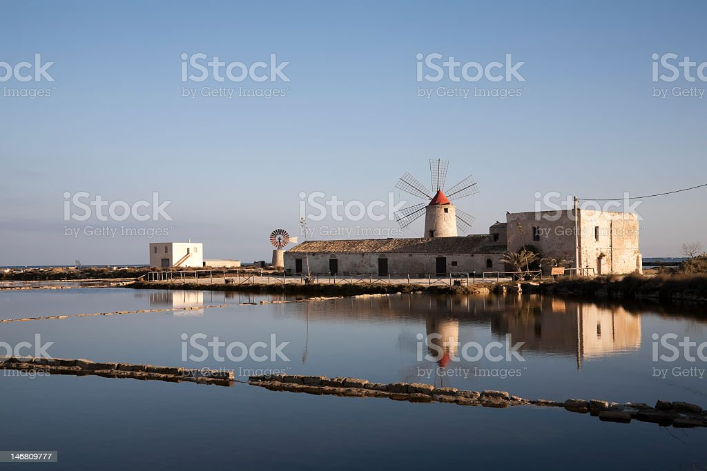 Old mill and salt field royalty-free stock photo