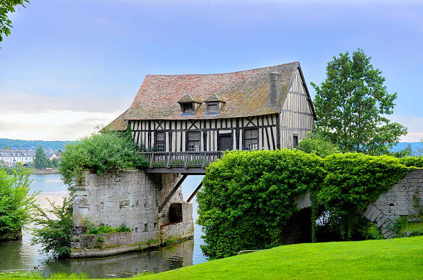 Old mill house on bridge, Seine river, Vernon, Normandy Old mill house on bridge, Seine river, Vernon, Normandy, France normandy stock pictures, royalty-free photos & images
