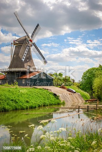 An old mill near the city of Deventer (Overijssel, The Netherlands). The city is largely situated on the east bank of the river IJssel and was once part of the Hanseatic league