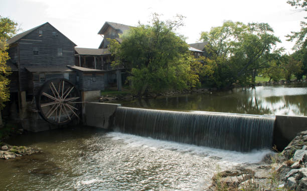 Old Mill The Little Pigeon River flows by an old grain mill in Pigeon Forge Tn pigeon forge stock pictures, royalty-free photos & images