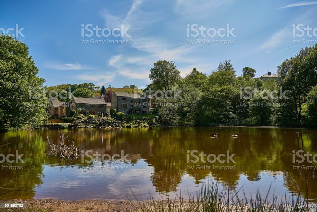 Old Mill Pond at Marsden, a tranquil summer scene royalty-free stock photo