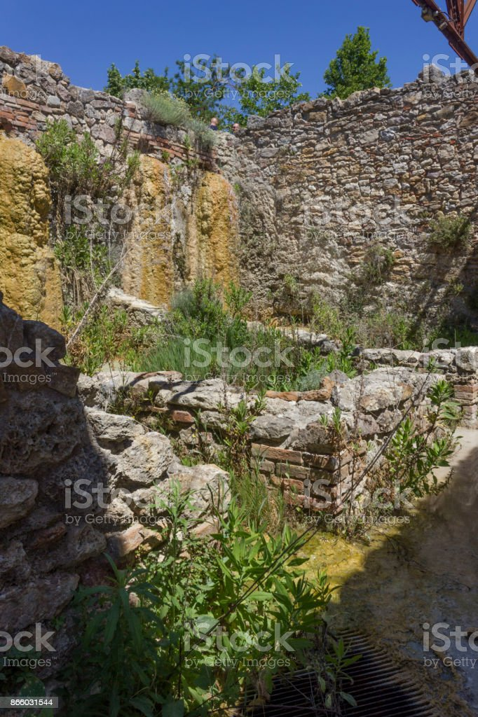 Old mill ruins in the hot springs area of Bagno Vignoni stock photo