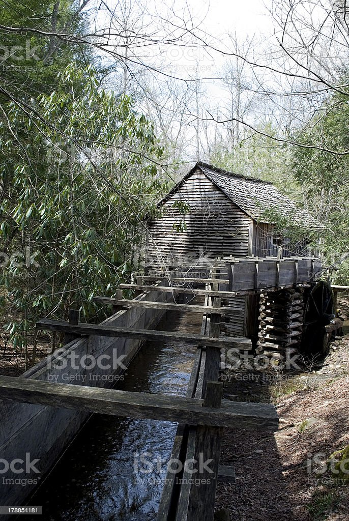 Old mill with water chute royalty-free stock photo