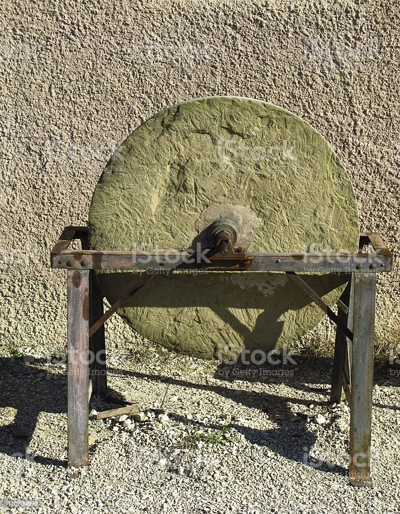 Old millstone stock photo