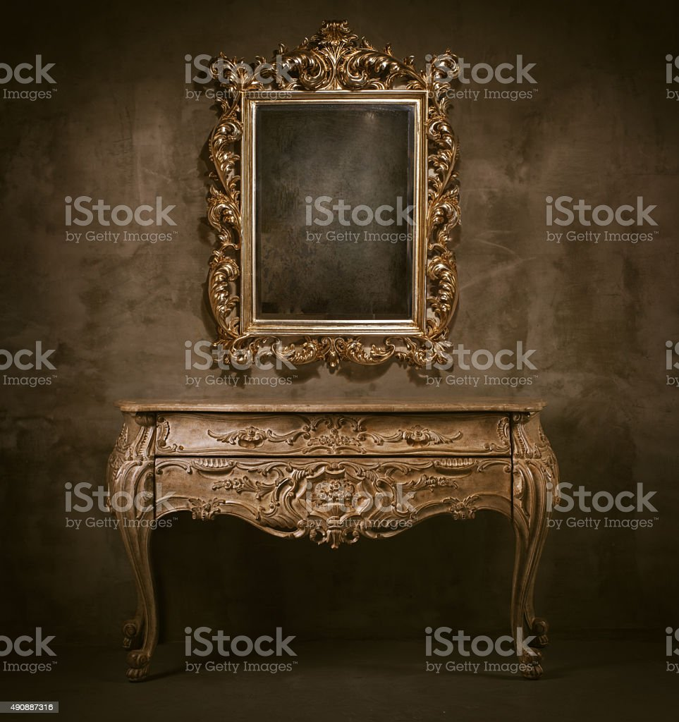 Old mirror and commode stock photo