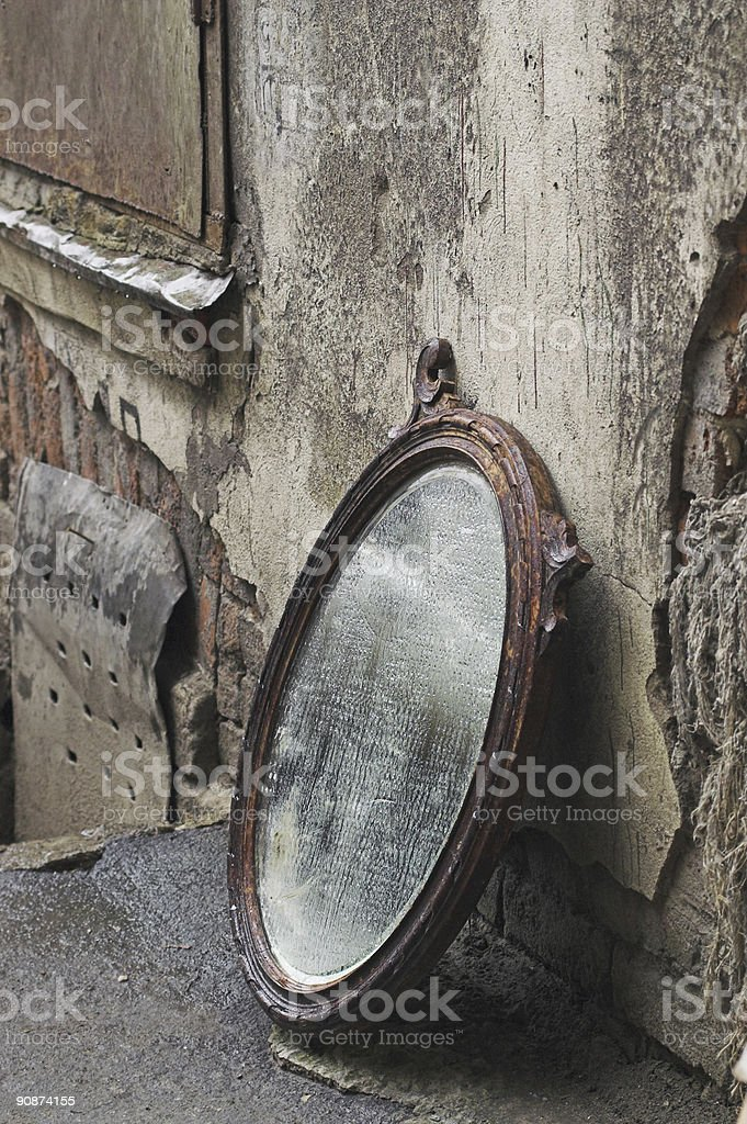 Old Mirror Standing Against Wall stock photo