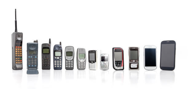old mobile phone from past to present on white background. - the past stock photos and pictures