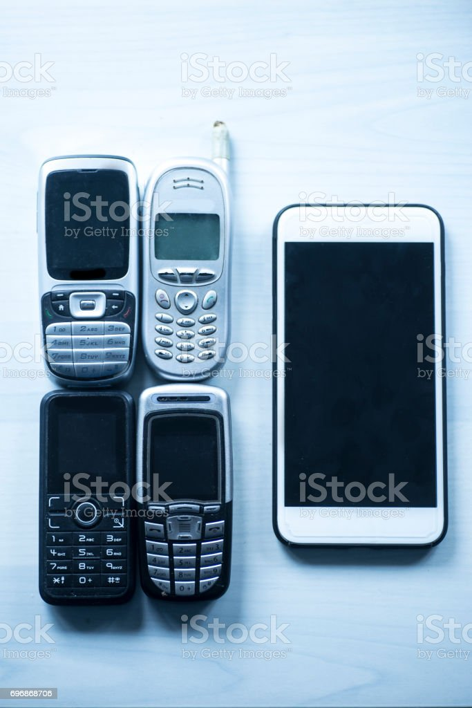Old mobile phones and new smartphone stock photo