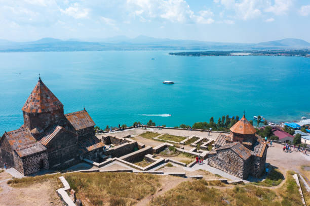 old monastery on shore of lake Sevan old Sevanavank monastery on the shore of lake Sevan in Armenia. in summer on a clear Sunny day. photography from the quadrocopter. the view from the top tuff stock pictures, royalty-free photos & images