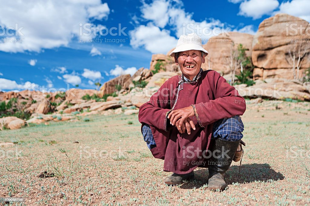 Old Mongolian man in national clothing, Central Mongolia stock photo