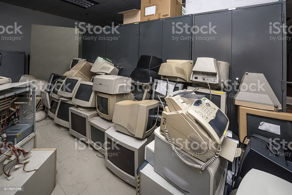 Old monitors and computer parts Old monitors and computer parts in office Abandoned Stock Photo