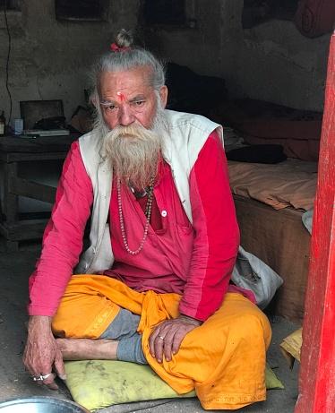 Pharping Nepal-may 2018: Old monk hermit at Dakshinkali temple, a Hindu goddess Kali.