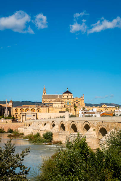 Old monumental bridge over Guadalquivir river in Cordoba, Spain stock photo