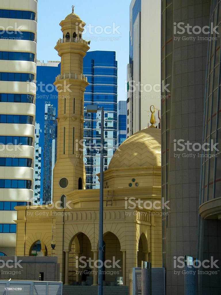 Old Mosque and Modern High Rise Buildings Abu Dhabi royalty-free stock photo