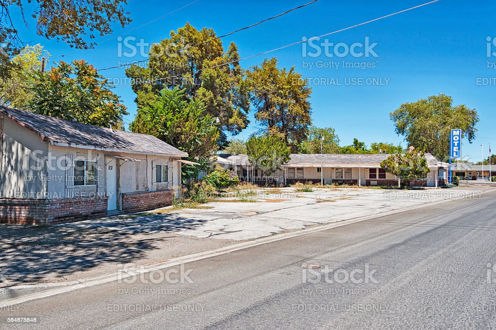 Old Motel beyond its prime in Nevada desert Community stock photo