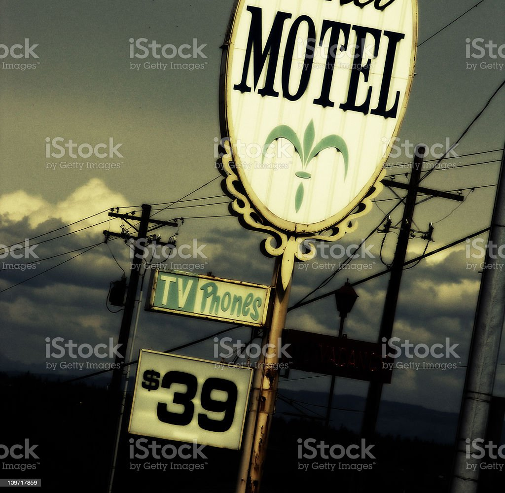 Old Motel Sign off of Highway royalty-free stock photo