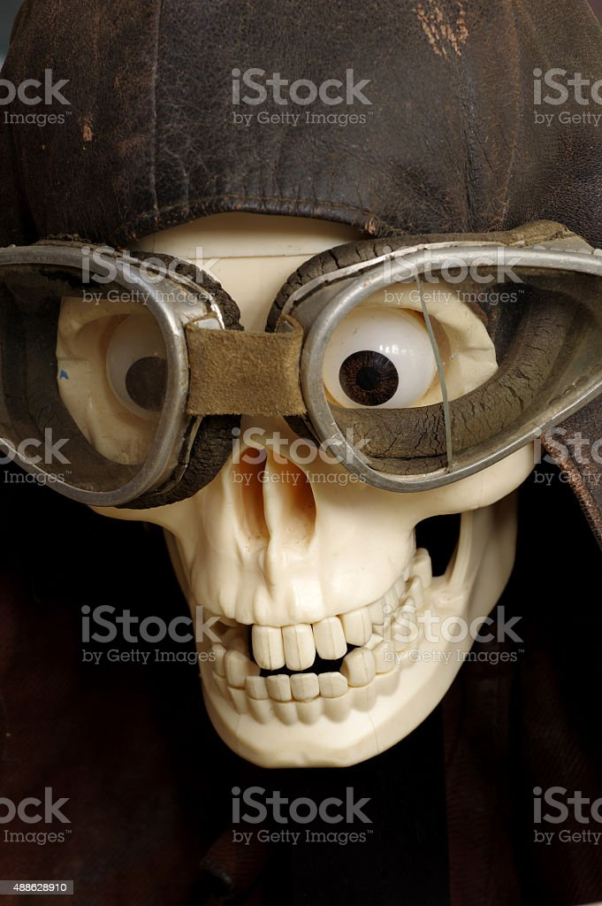 old motorcycle goggles and helmet the skull stock photo
