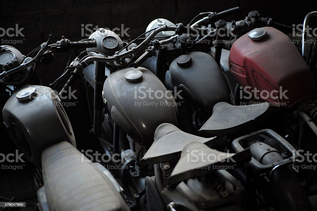 Old motorcycle in a row stock photo