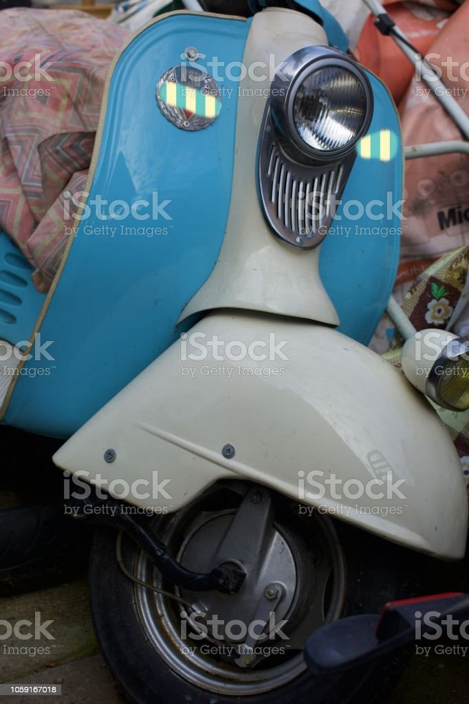old motorcycle wheel  in a garage stock photo