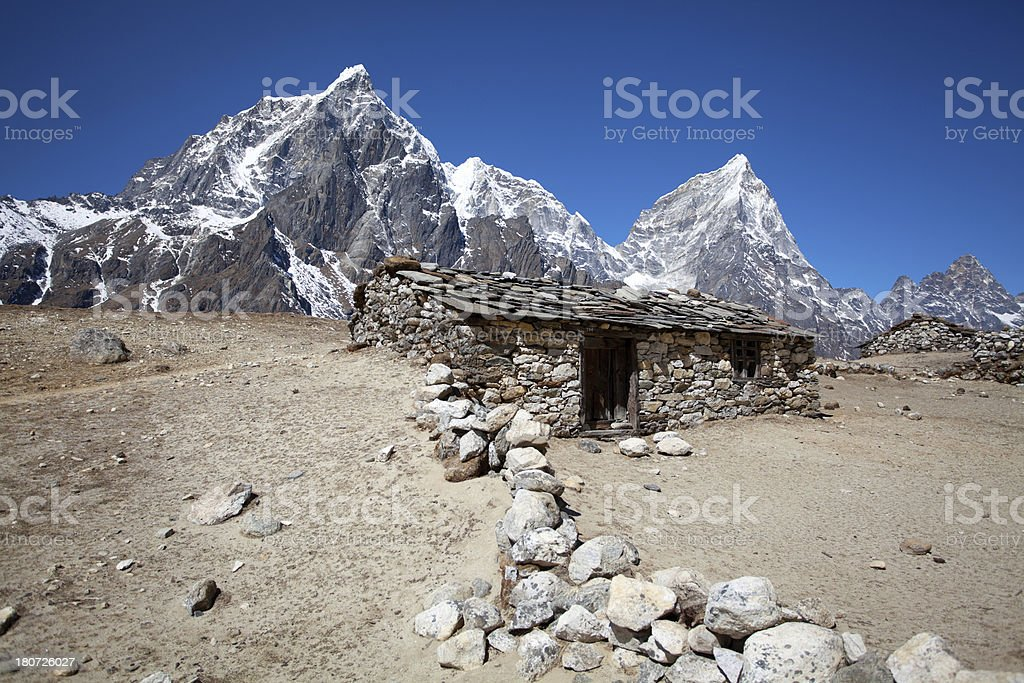 Old mountain hut made of stone in the Himalayas royalty-free stock photo
