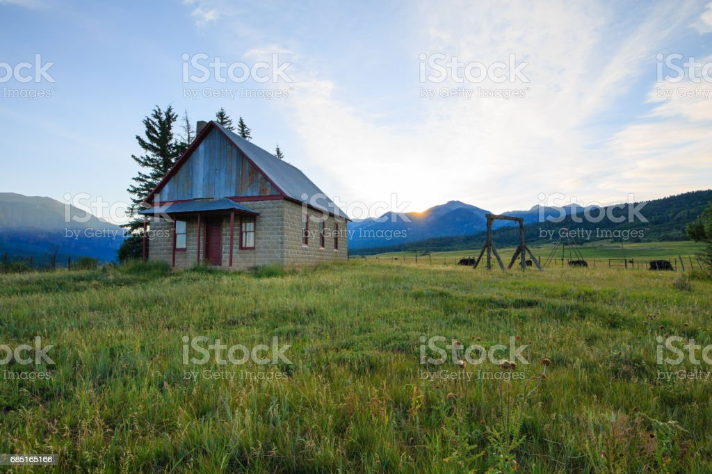 Old Mountain School House at sunrise royalty-free stock photo