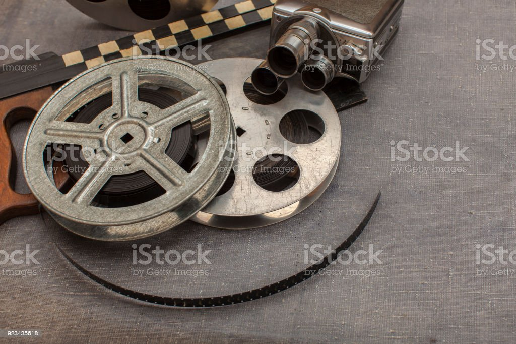 Old movie camera film reels and clapperboards stock photo more old movie camera film reels and clapperboards royalty free stock photo altavistaventures Choice Image