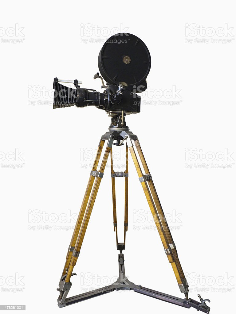 Old movie camera on a tripod stock photo