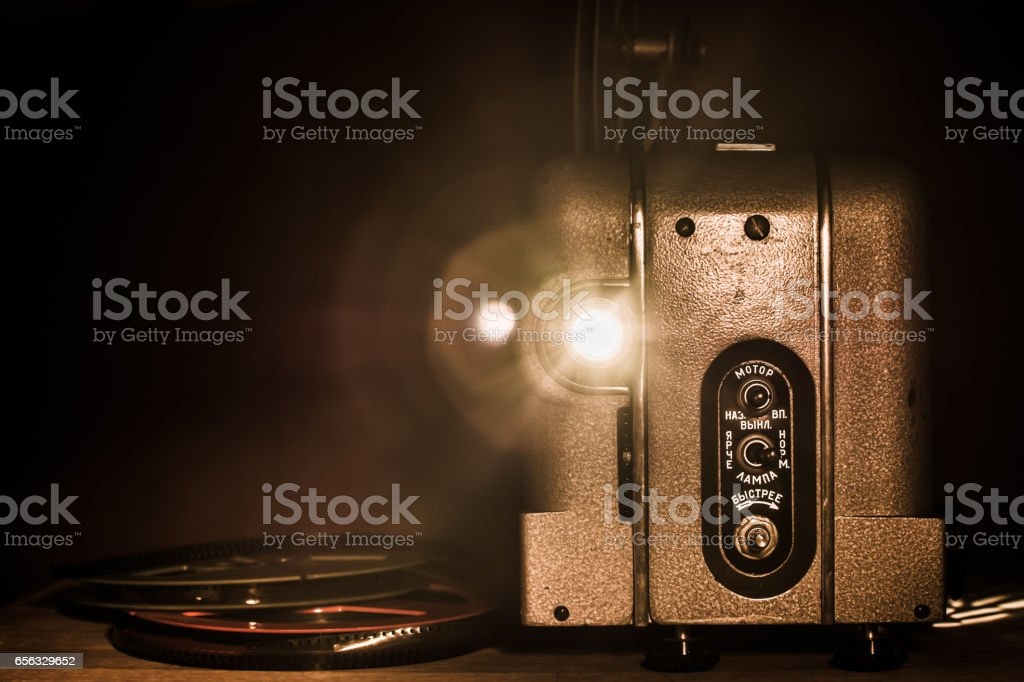 Old movie projector, front view. stock photo