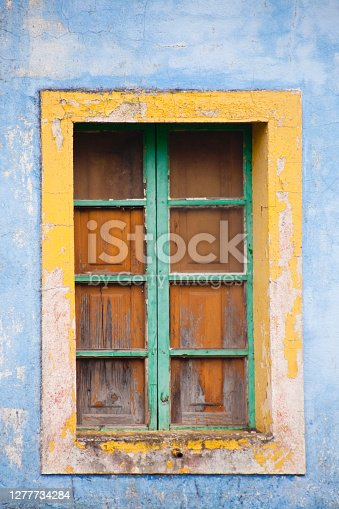 istock Old multicolored weathered house facade seen from the road. Lugo province, Galicia, Spain. 1277734284
