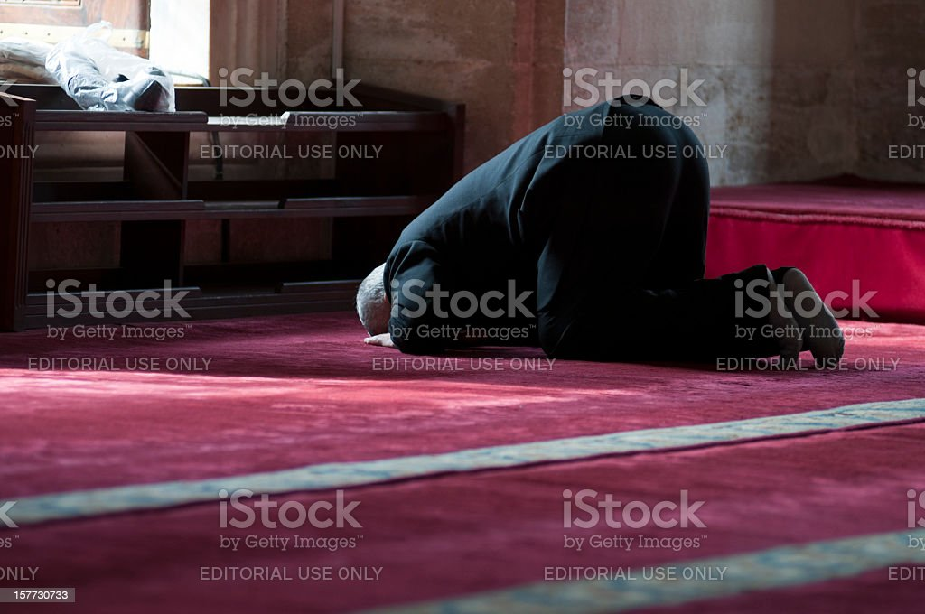 Old muslim man praying in the Blue Mosque, Istanbul, Turkey royalty-free stock photo