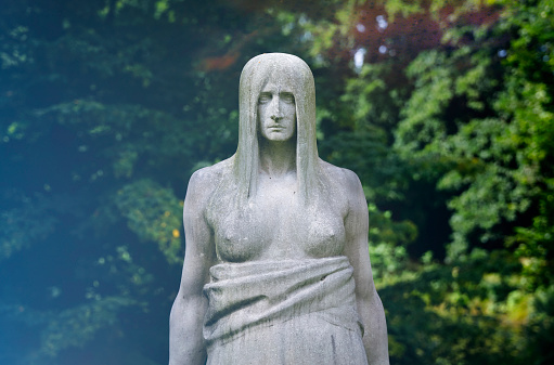 Old mystic sculpture at the Ohlsdorf Cemetery, Hamburg, Germany