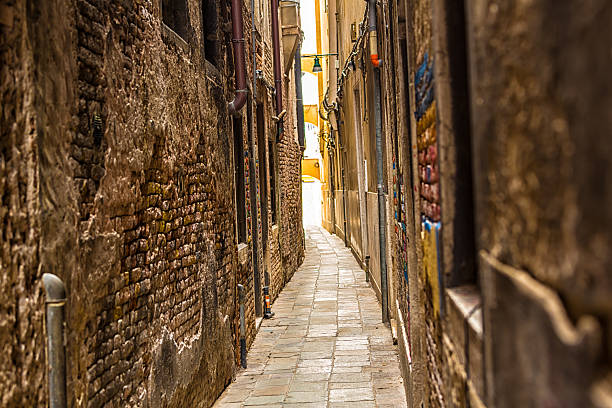 Old narrow alley in Venice Old narrow alley in Venice narrow stock pictures, royalty-free photos & images