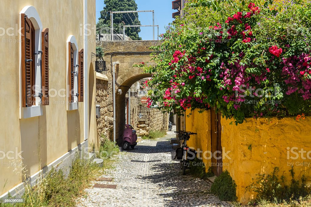 Old narrow medieval streets in Old Town of Rhodes, Greece stock photo