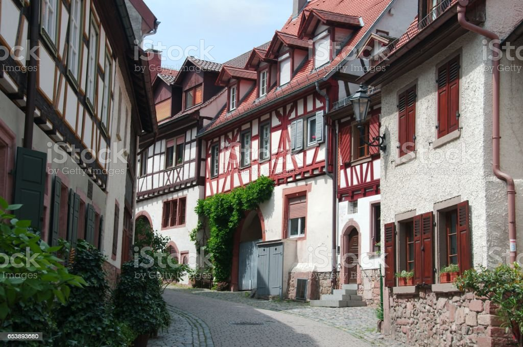 Old narrow street with half-timbered houses of the Gerberbach Quarter in Weinheim, Germany stock photo