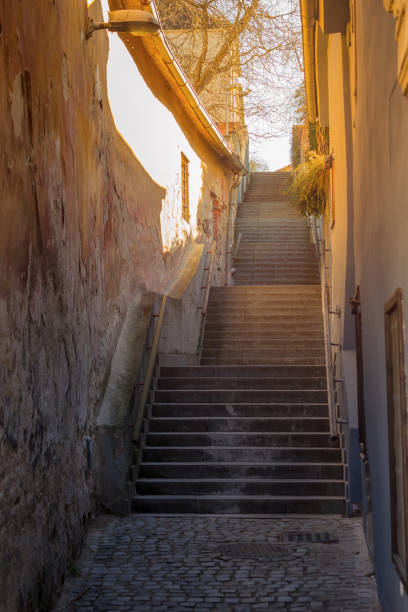 old narrow street with stairs stock photo