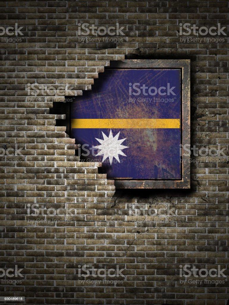 Old Nauru flag in brick wall stock photo