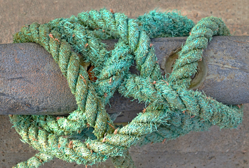Old Nautical Rope Tied To A Rusty Metal Cleat Close Up Abstract Stock Photo  - Download Image Now - iStock