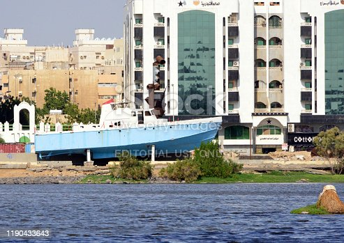 Jeddah, Mecca Region, Saudi Arabia: old navy patrol boat on the western shore of Al Arba'een lake, office buildings along Hail street - Al Balad district